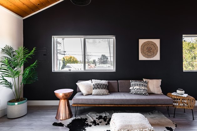 charcoal gray paint colors in living room with wood ceiling, gray couch, and cowhide rug