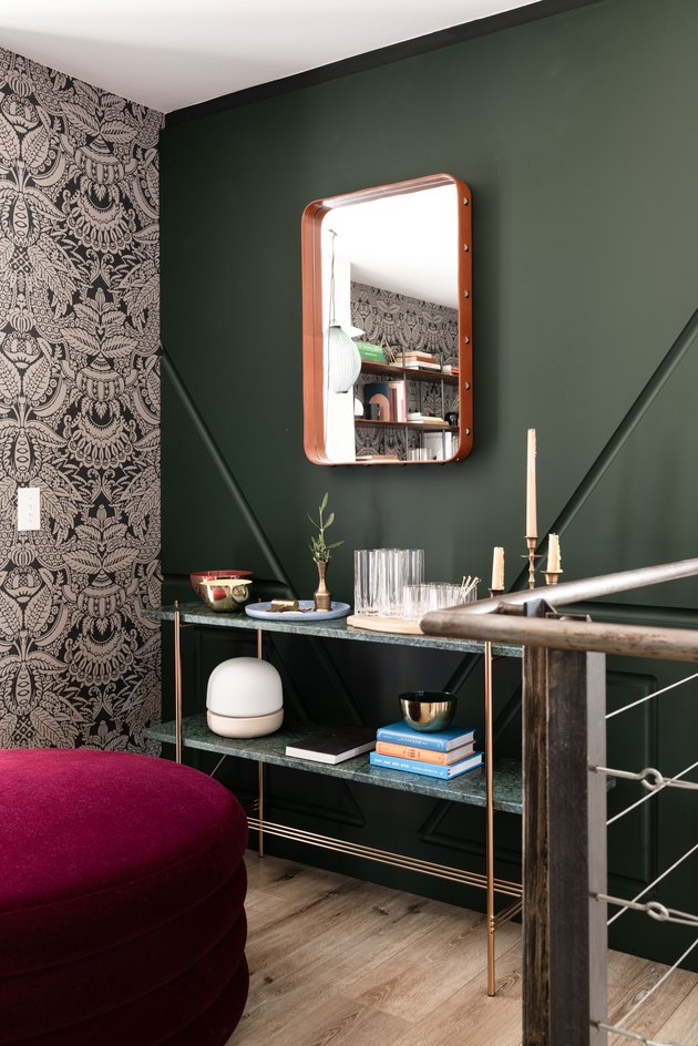 Gubi TS console table in front of green accent wall