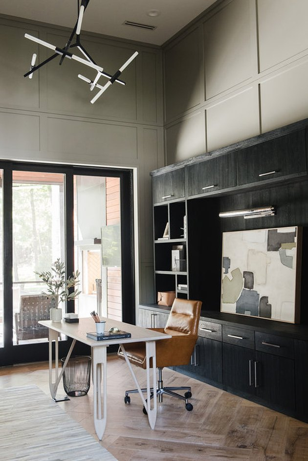 mossy gray paint colors in office with wall paneling and black bookshelf