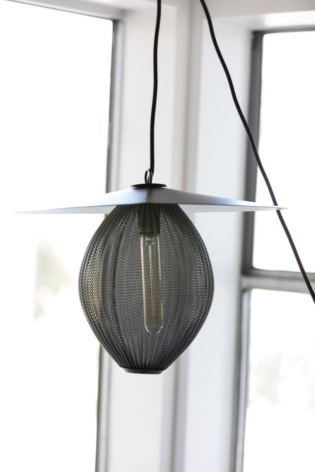 Gubi Satellite Pendant Lamp hanging near windows