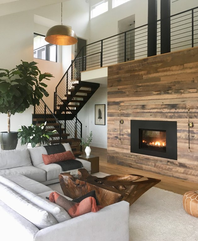 Rustic living room idea with large wood fireplace