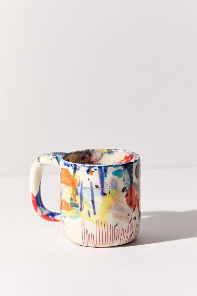 multicolored ceramic mug