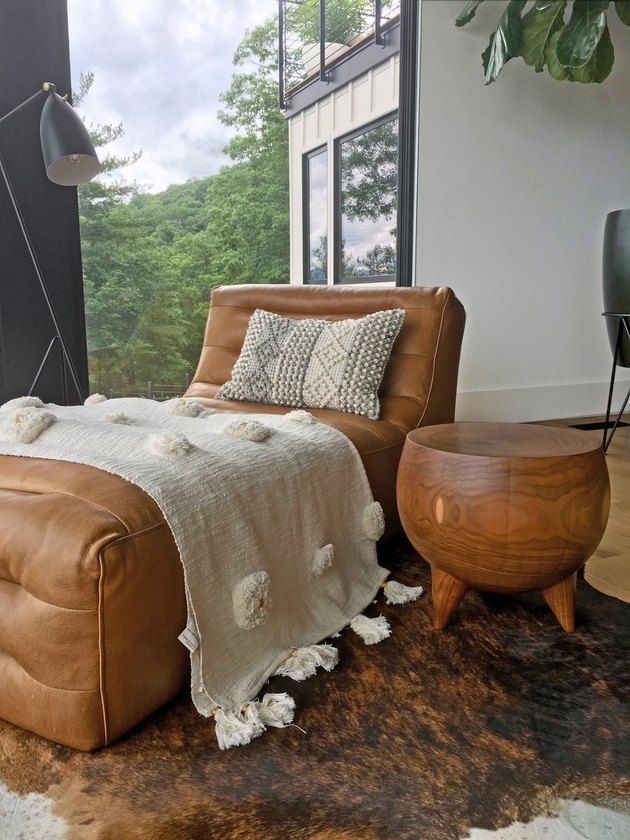 Rustic living room idea with leather chaise with textured throw blanket