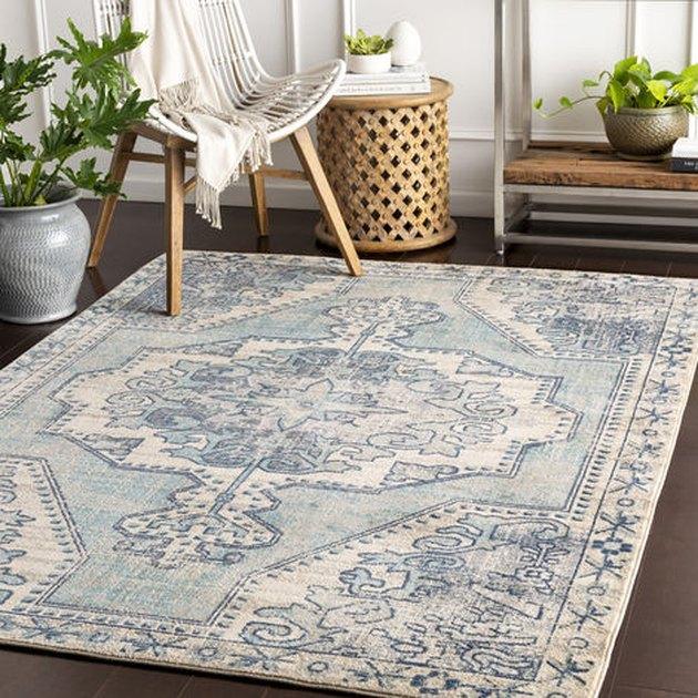 celadon colors in rug over dark wood floor