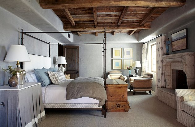 gray paint colors in bedroom with exposed wood ceiling beams and canopy bed