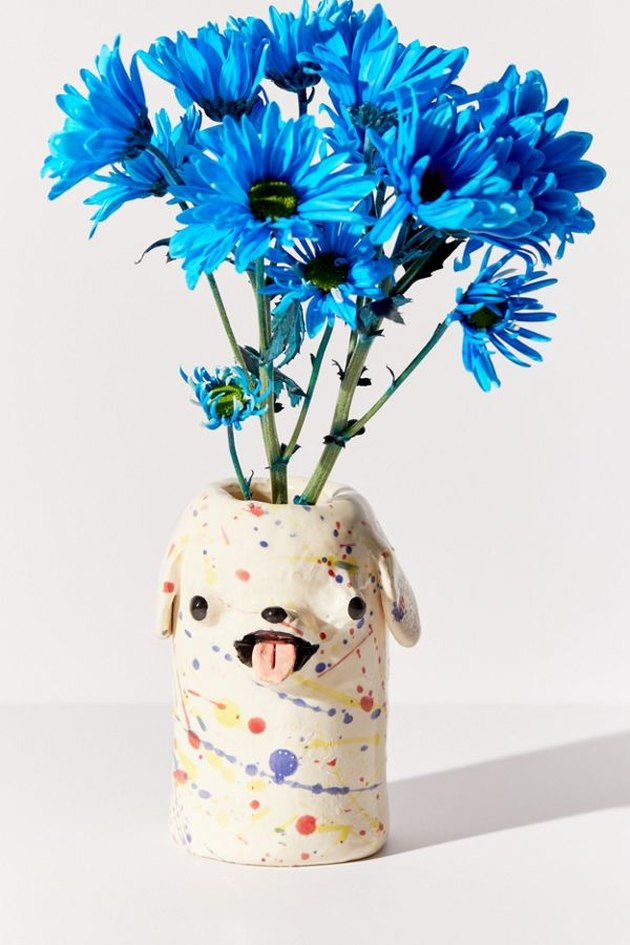 multi-colored dog-shaped vase with blue flowers