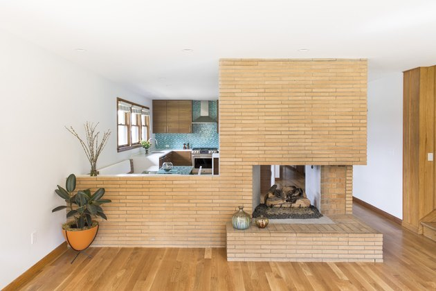 original double-sided midcentury brick fireplace