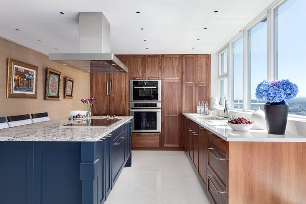 kitchen with wood cabinetry and blue island