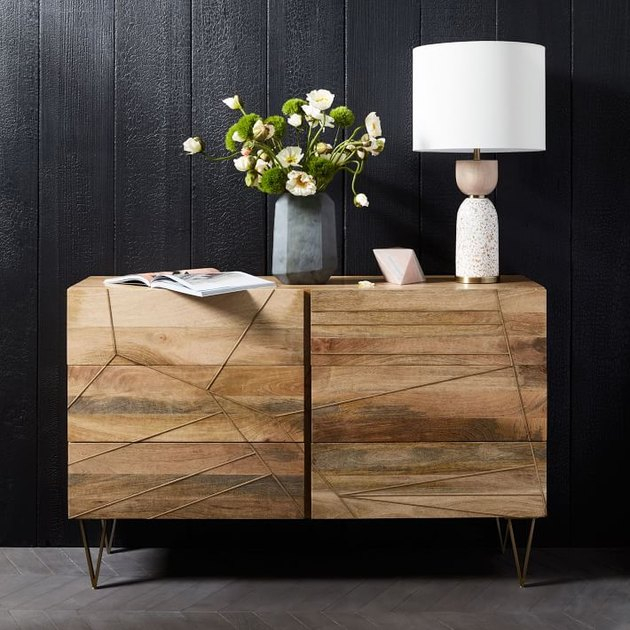 West Elm brass inlay dresser with six drawers and table lamp on top