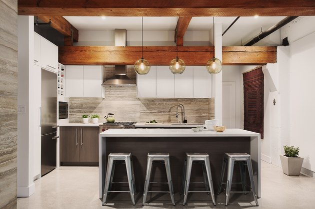 kitchen with glass pendants and exposed beams