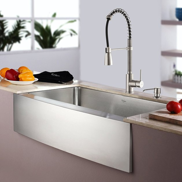 Stainless steel sink with apron