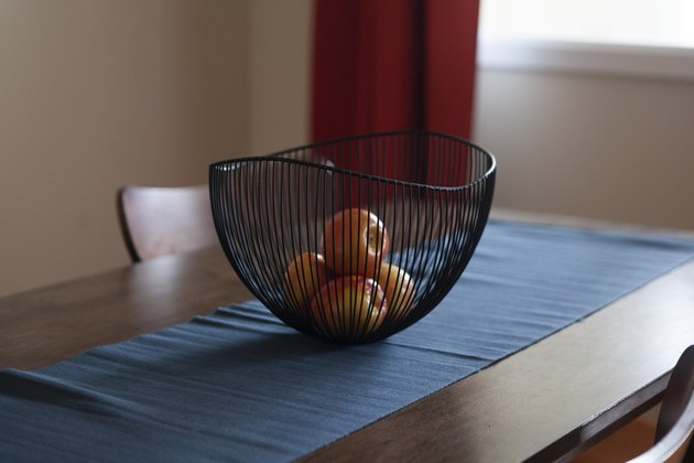 Bowl on dining table with fruit