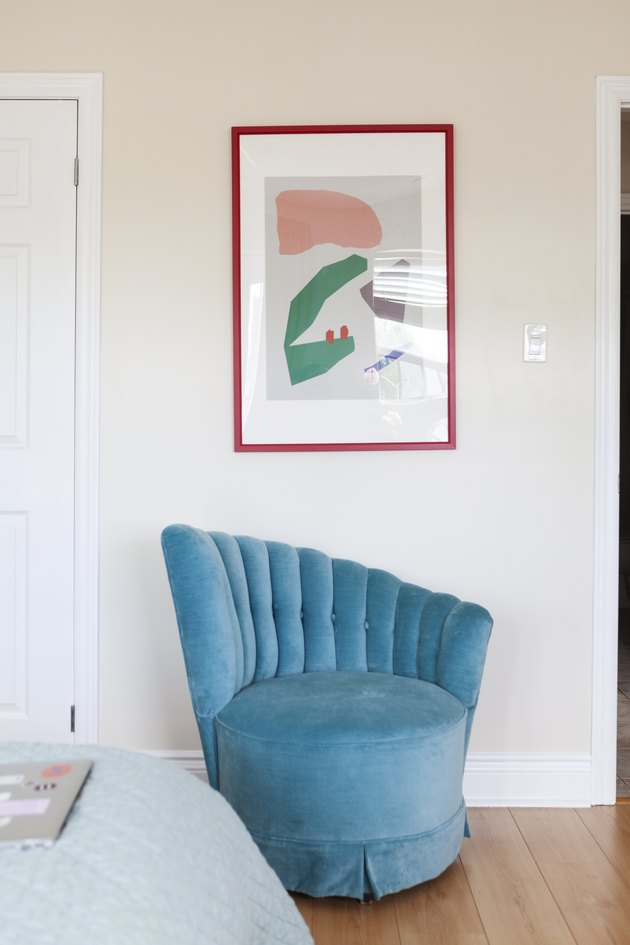 Blue velvet chair and artwork