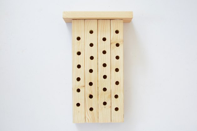 Bee house with wooden roof attached