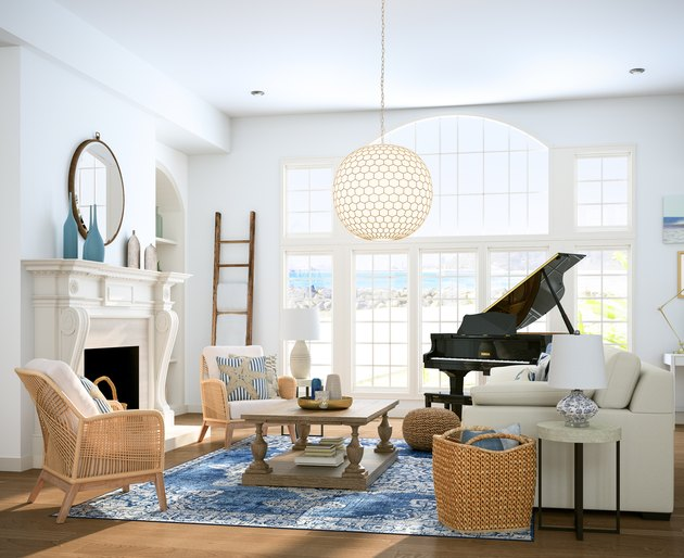 Living room with chairs, coffee table, piano, and lamp