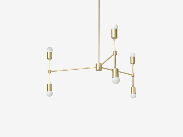 contemporary brass pendant light with three double-sided arms featuring small white bulbs on each side