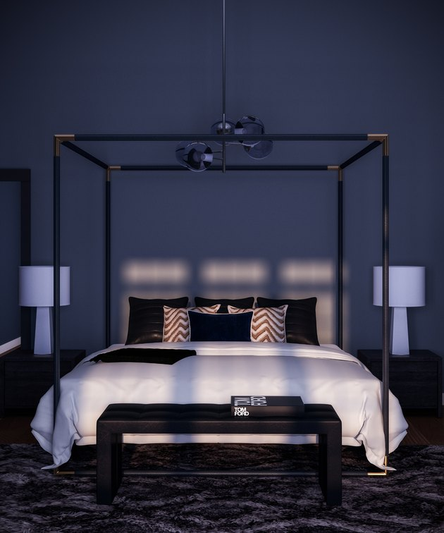 bedroom with large black frame and two lamps on either side