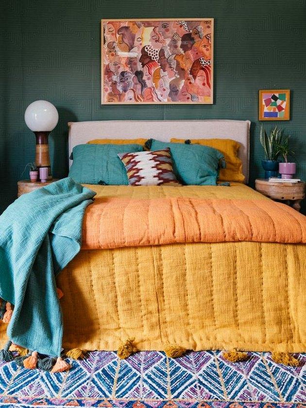 ochre color bedding in green bedroom