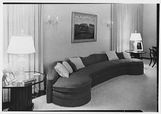 1930s living room with curved sectional sofa