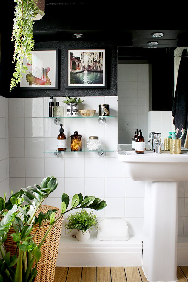 black-and-white bathroom idea with black ceiling and white tile walls