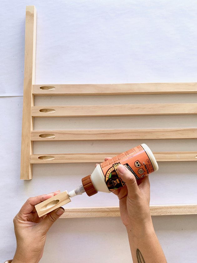 Wood dowels and glue for modern towel rack DIY