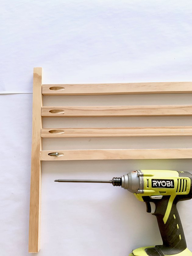 Wood dowels and drill for modern towel rack DIY