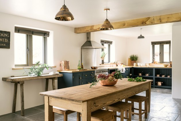 Country kitchen window with Venetian blinds and exposed wood beam