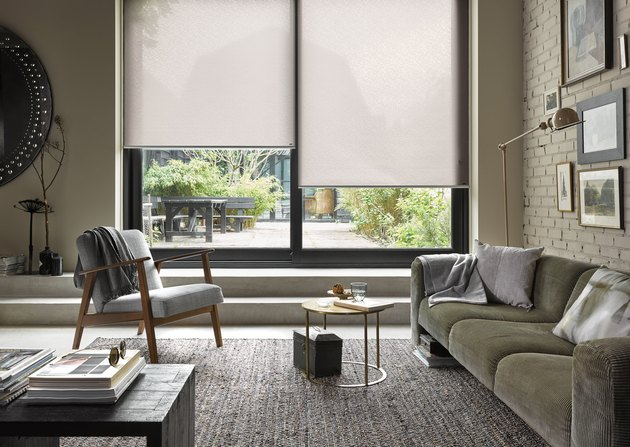 window treatments for sliding glass doors in large modern living room with glass sliding doors and roller blinds