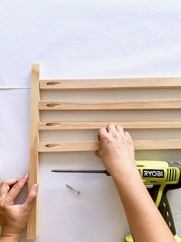 Placing wood dowels together for towel rack DIY
