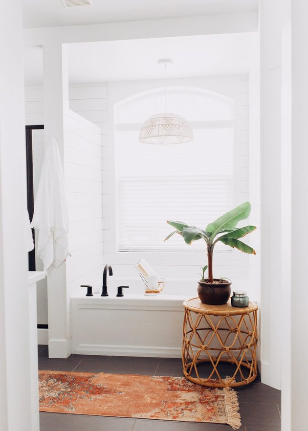bathroom idea with rattan stool for minimalist decorating on a budget
