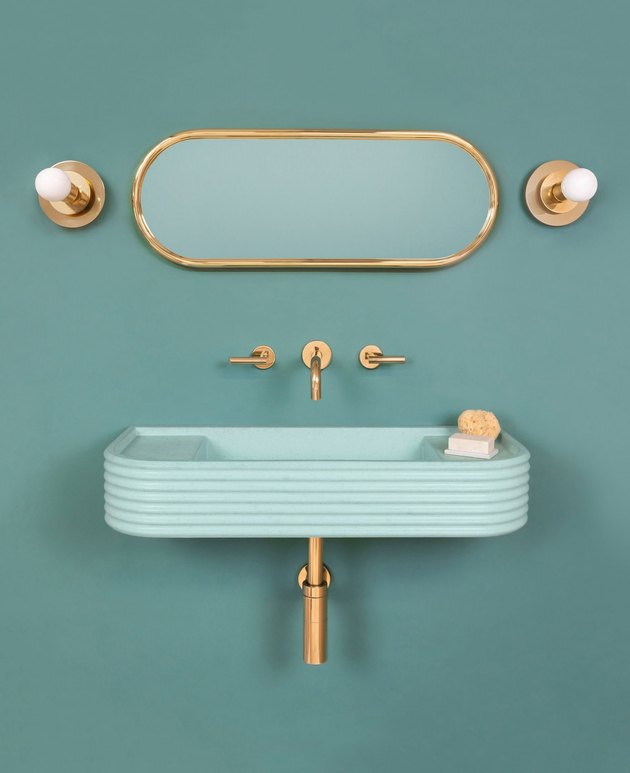 Turqoise bathroom sink idea with brass fixtures