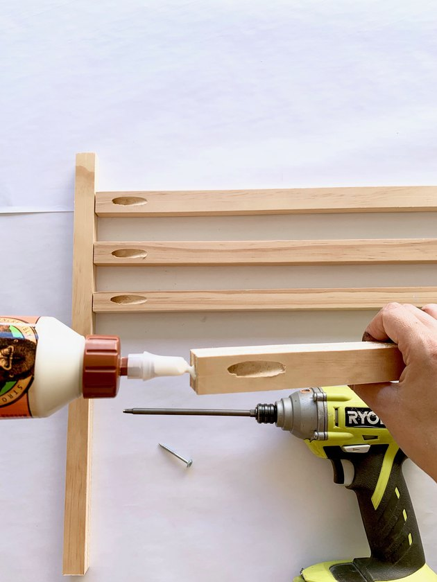 Wood glue, drill, and wood dowels for modern towel rack DIY