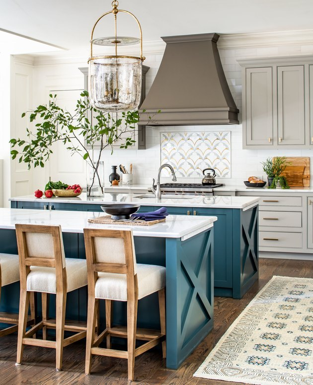 double traditional kitchen island with wood barstools