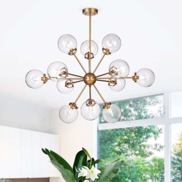 Sputnik chandelier with 12 clear globes and aged brass base