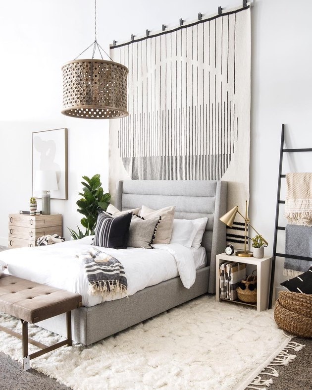bedroom wall decor idea with oversize area rug
