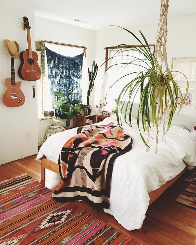 Bedroom wall decor idea with hanging guitars