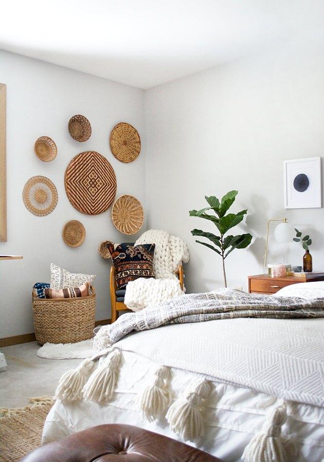 Bedroom wall decor idea with baskets on bedroom wall