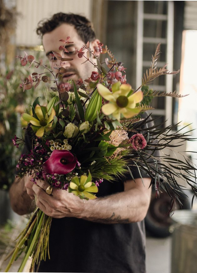 Spencer Falls designs a floral bouquet