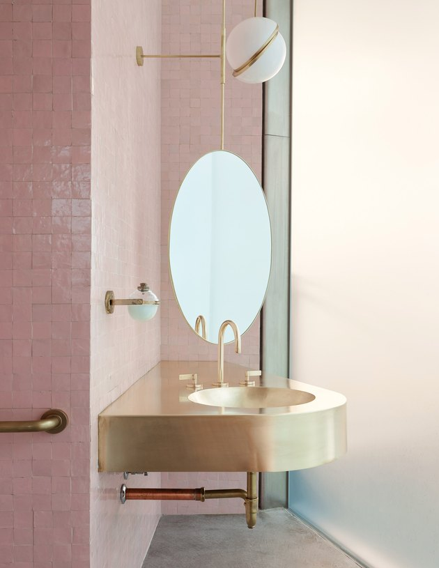 gold bathroom sink idea in pink bathroom