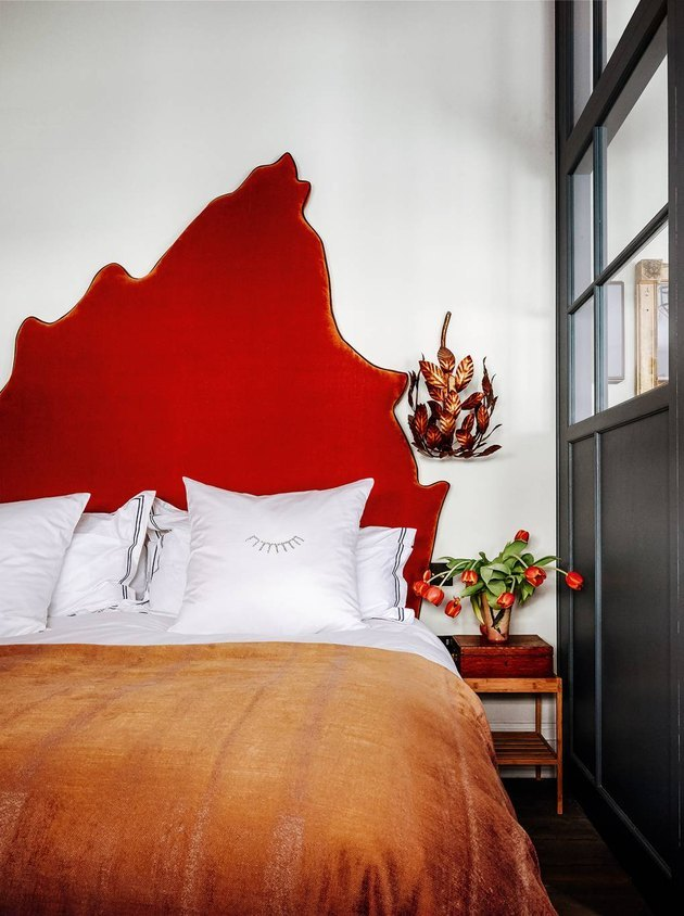 colors that go with red in a white bedroom with red headboard and orange throw blanket
