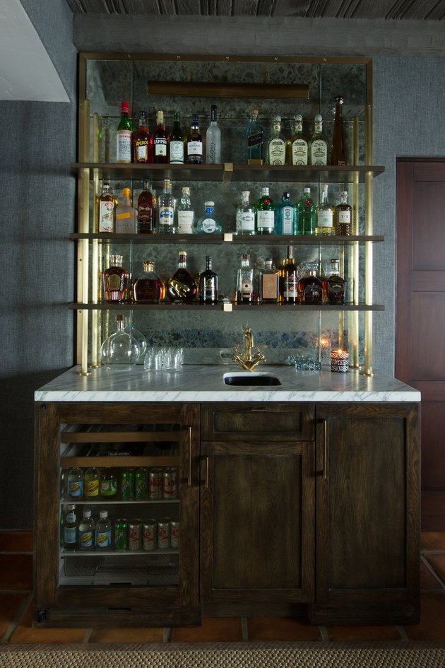 glam rustic bar ideas with gold shelves and marble counter