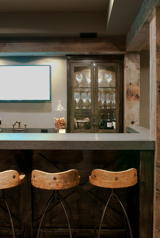 dark and moody rustic bar ideas with wood and metal bar stools
