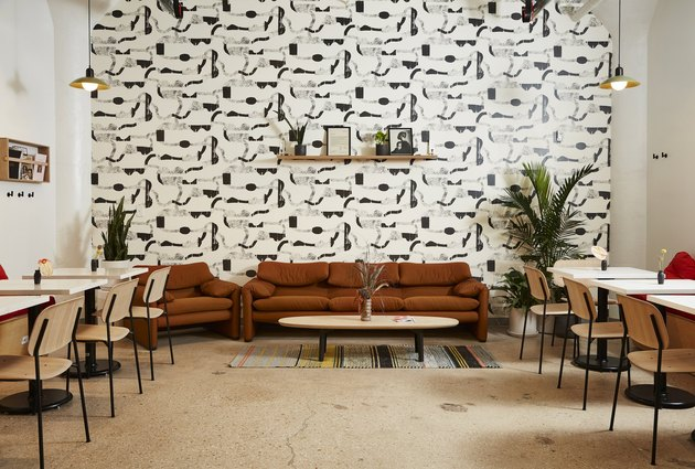 dining space with black and white wallpaper