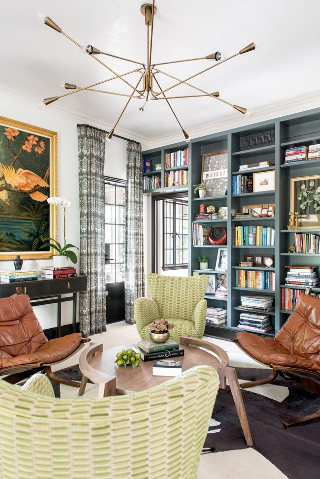 chartreuse color idea in white living room with green lounge chairs