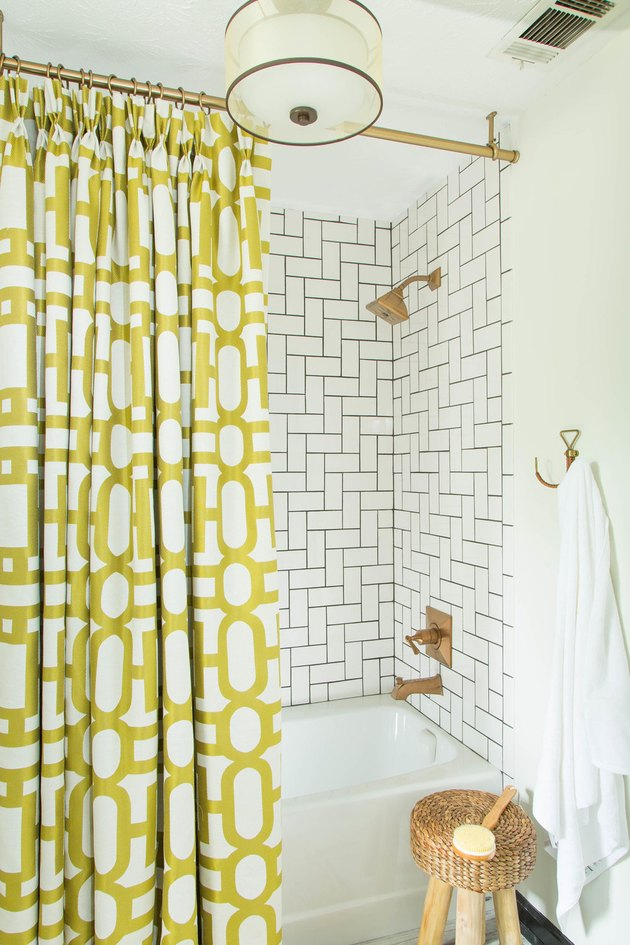 chartreuse color idea in bathroom with patterned shower curtain