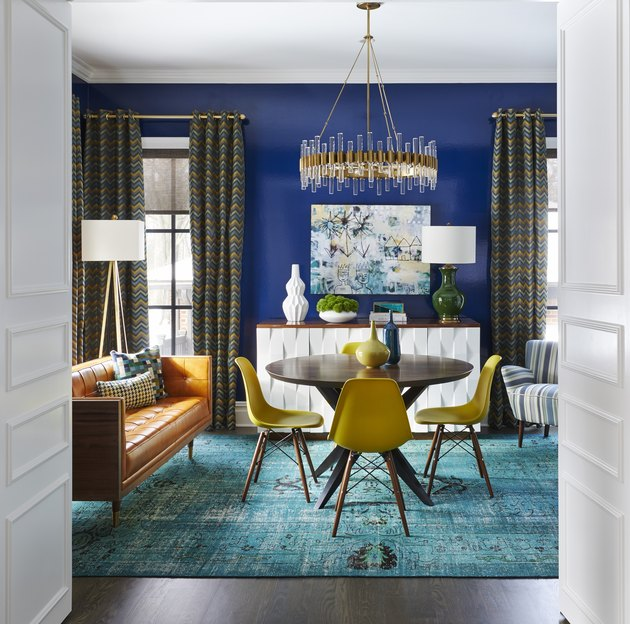 room with blue wall and teal rug