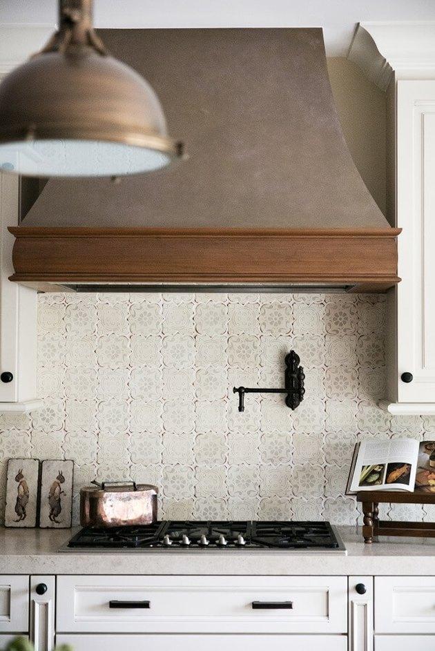 neutral patterned tile kitchen backsplash with antique details