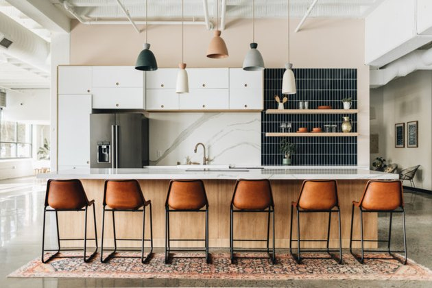 industrial kitchen with marble and navy subway tile kitchen backsplash