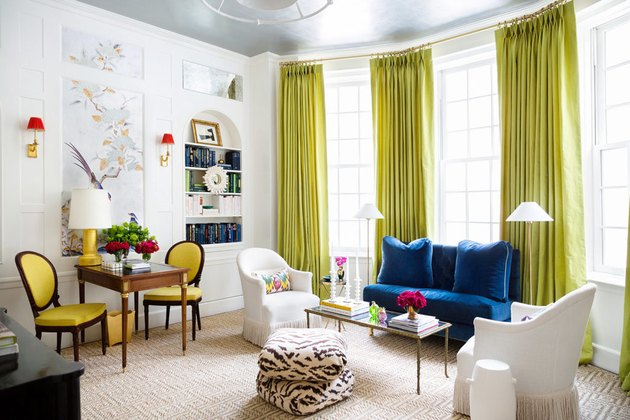 chartreuse color idea in white living room floor-to-ceiling drapery