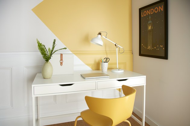 desk with yellow chair and yellow and white wall